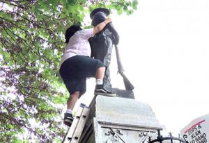 Comrade Takiya Thompson takes down the statue of the Confederate. August 14, 2017